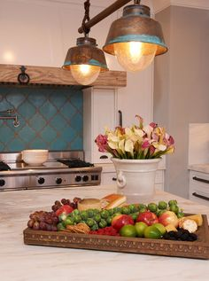 Tired of humdrum? Check out the turquoise tiling and rustic lighting in this gorgeous kitchen!