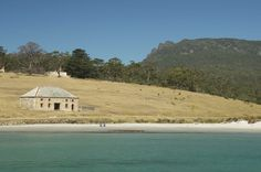 Commissariat Store with Bishop and Clerk Mountain in the background on stunning Maria Island.