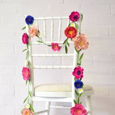 I love this but instead of over a chair I would make an arch to go over where the ceremony is held.  Colour to be adapted slightly to the theme, I don't want it too matchy.