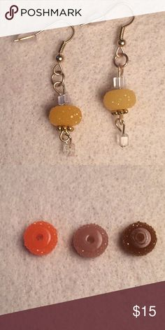 Handmade yellow chandelier earrings 🆕 Handmade lemon yellow chandelier earrings. Each earring is made with 2 small square clear beads, 1 sparkly looking yellow doughnut shaped bead, and gold colored accents. Each earring is about 2 inches long 💎Also available in orange, light brown, and dark brown. See bottom photo for colors💎 All beads are made of glass Handmade Jewelry Earrings