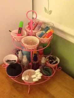 DIY Dresser Organizer made from a cheap wire cupcake holder! You can put in cupcake wrappers to support things that might fall out. Also, there is open space for bottles in the center. Plus, it's a great home for sock buns.