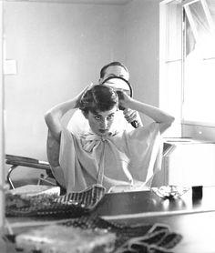 Audrey Hepburn having her hair cut circa 1953.