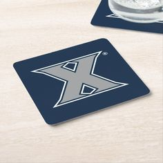 Shop Xavier University Mark Square Paper Coaster created by xaviermusketeers. Personalize it with photos & text or purchase as is! Xavier University, Brand You, Coasters, Monogram, Student, Musketeers, Paper, Cork, How To Make