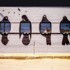 A mural of blackbirds frames four windows on a building in Deep Ellum, Dallas, Texas   photo by 75Central Photography
