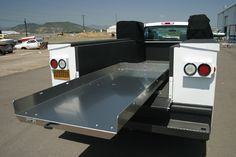 A truck bed slide out cargo tray for your pickup truck. This extension slide holds up to a 4000 lb capacity and locks every ten inches. Truck Bed Caps, Truck Bed Slide, Truck Bed Covers, Truck Tools, Truck Tool Box, Toy Hauler Trailers, Car Trailer, Trailer Storage, Truck Storage