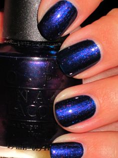 I got a mani done in this, from the OPI Axxium collection (like Shellac)   The color is Russian Navy, and I am OBSESSED.