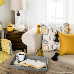 Use a pom-pom maker and yarn to turn plain pillows into a statement piece!