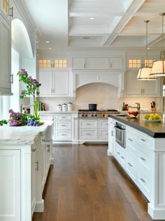 2014 Design Kitchen - black island top and white surrounding.  I like this idea for my kitchen.
