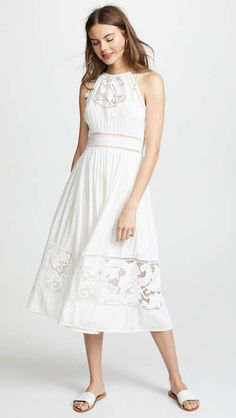 Ulla Johnson Hania Dress. Crafted in lightweight cotton and finished with delicate lace, this Ulla Johnson dress is the summer dress you've been searching for. Whether you are planning a vacation or a date night outfit, this breezy style has got you covered.