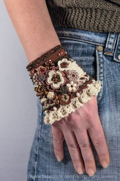 This unique bracelet cuff is crochet from cotton thread with resistant colors. Its center is decorated with crochet beaded flowers. Freeform Crochet, Bead Crochet, Unique Bracelets, Cuff Bracelets, Pandora Bracelets, Crochet Beaded Bracelets, Crochet Gloves, Wrist Warmers, Fabric Jewelry