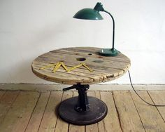 table created of bits and pieces - part of a wooden spool tops it for interesting texture and age Large Wooden Spools, Wooden Spool Tables, Wooden Cable Spools, Wire Spool, Diy Pallet Furniture, Unique Furniture, Home Furniture, Rough Wood, Wood And Metal