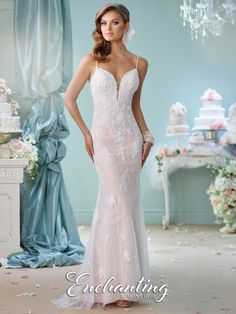 Size 6 White-Nude, Enchanting by Mon Cheri 116144 is a hand-beaded lace fit and flare informal bridal gown with spaghetti straps, deep plunging sweetheart neckline with illusion modesty panel, unique illusion and lace back, and sweep train.