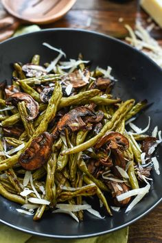 Balsamic Roasted Green Beans and Mushrooms are loaded with flavor and great for a quick weeknight side dish or your Thanksgiving table!