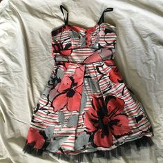 Floral and Stripe Dress Super cute bustier style juniors dress. Bustier is slightly padded. Tulle on bottom is not under whole dress, just the very bottom as shown. Tie at back and adjustable spaghetti straps. Sequin Hearts Dresses Mini