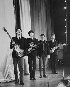 1963: Pop group The Beatles take a bow on stage after performing in the Royal Command Performance at the Prince of Wales Theatre.
