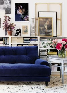 blue velvet sofa, lower bookcases, artwork, eclectic style
