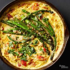 Crab and Asparagus Frittata - Who knew an extravagant seafood and veggie breakfast was possible in your own kitchen? For neat presentation, use thin asparagus spears and simply snap off the ends before topping the frittata.
