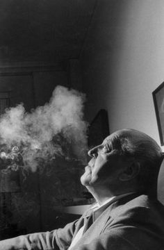 Image 1 of 10 from gallery of Mies, the Modernist Man of Letters. Mies van der Rohe with smoke, photographed for Life magazine. Image Courtesy of Frank Scherschel/Time & Life Pictures/Getty Images Ludwig Mies Van Der Rohe, Bauhaus, Walter Gropius, Frank Gehry, Metropolis Magazine, Kenzo Tange, Men Of Letters, Louis Kahn, Philip Johnson