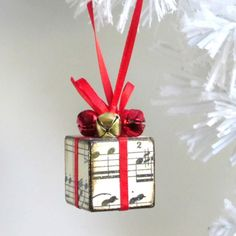This little sheet music ornament is adorable! How festive with bells and red ribbon too #Christmas #piano