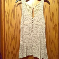 Adorable FP tank So soft and sweet and comfortable. Long tank / tunic looks great with jeans or leggings. In excellent condition. Free People Tops Tunics