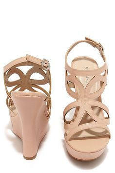 """We're not too proud to beg; especially when there are shoes as cute as the Pretty Please Nude Caged Wedge Sandals! Textured vegan leather sculpts a caged peep toe upper with an adjustable ankle strap, and silver buckle. A 5.25"""" wrapped wedge heel slides into a 1.25"""" toe platform. Cushioned insole. Nonskid rubber sole. Available in whole and half sizes. Measurements are for a size 6. All vegan friendly, man made materials."""