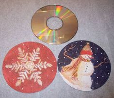 old CDs or the clear one that is a filler on the spindle of the pack, Christmas napkin, mod podge=decoration