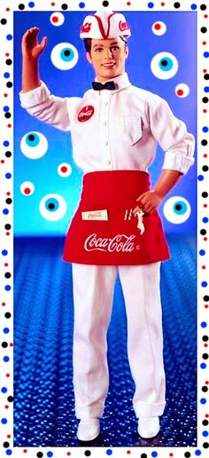 BARBIE enjoys her soda even more when it's served by her truly dreamy boyfriend KEN. His COCA-COLA uniform is adorned with a miniature bottle opener attached to his apron, along with a writing pad, pencil and straws for two. This very delicious soda-jerk Ken doll serves up memories of a time we'll never forget.
