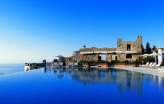 Hotel Caruso, Ravello, Italy:     11th-century palace with an infinity pool, terraced gardens, and classic-celebrity cachet (Jackie Kennedy; Humphrey Bogart). Doubles from $850–$1,073.    Behind the Scenes: The property is perched 1,000 feet above the Mediterranean; to tour the nearby harbors, hop aboard the hotel's 52-foot boat Ercole (trips from $615).