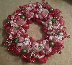 I made this Snowman Christmas Wreath to go above our fireplace. It turned out even cuter than I thought it would considering its my first diy mesh deco wreath. I got all the supplies at Hobby Lobby.