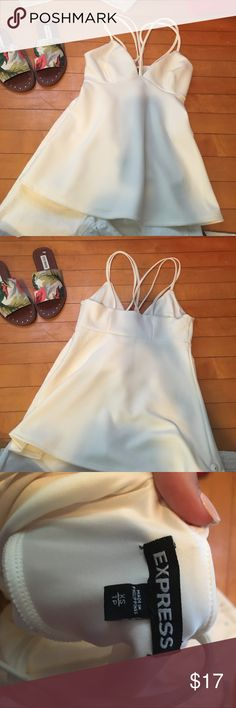 """Express """"going-out"""" shirt Cream colored flowy blouse with criss-cross front & back. Very flattering. NWOT. Shoes are also for sale. Bundle & save!!❤️❤️ offers welcome! Express Tops Blouses"""