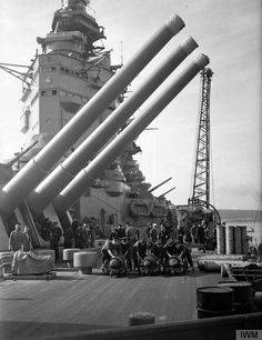 """Crew moving 16"""" shells across the deck of HMS Nelson in July 1941, two months after she fatally mauled the German battleship Bismarck."""