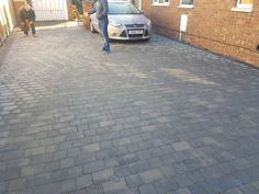 Recently installed block paved driveway installed with grey tegula blocks in two sizes. #blockpaving #driveway #drivewaycompanies #peterboroughimprovements