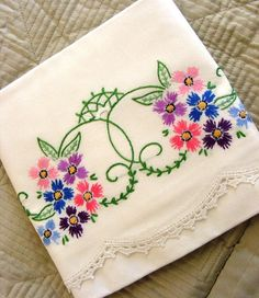 Embroidered pillowcases -- all our pillowcases were like this when I was growing up.