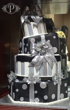 Happy New Year's from Palermo's! This four tier custom wedding cake was made for the 2012 winter wedding season with edible glitter luster dusted bows adorning the black and silver gift boxes.