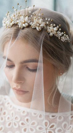 This absolutely Etherial and Romantic Bridal Headband Tiara is just Breathtaking in person! An instant heirloom piece with classic style and elegance and the Sparkle is absolutely Beautiful in the hair under the lights!!! This tiara's classic styling and truly regal elegance makes it an instant heirloom piece. #bridaltiara #tiara #princesstiara #handmade #bride #bridalhair #bridalveil #weddings #affiliatelink #bridal
