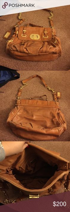 Badgley Mischka camel colored bag Badgley Mischka camel colored bag with gold strap and gold detail. 2 side zippered pockets. Inside zipper pocket. 2 built in pockets inside. In good condition! Dust bag included. Strap can come off and be used as a messenger bag Badgley Mischka Bags Satchels