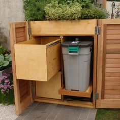 recycling and rubbish bin storage with planter Garage, ideas, man cave, workshop, organization, organize, home, house, indoor, storage, woodwork, design, tool, mechanic, auto, shelving, car.