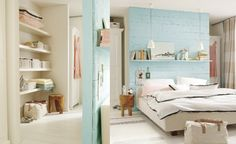 Love the idea of a closet behind the bed.  The wood wall makes a great headboard.