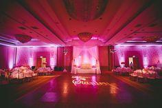 hotel ballroom reception. sweetheart canopy. purple pink uplights