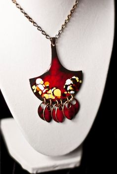 Red, Black, Yellow, White, Orange Vitreous Glass Enameled Ax blade pendant with dangling scales