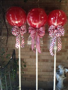 Outside Christmas decorations  Red rubber balls from Walmart.  Bows & cellophane from Hobby Lobby.  PVC from Lowe's  Glue balls to 3/4 inch 4 ft high PVC.  Wrap balls with cellophane attach your bow. I got one inch round 4 inches long PVC and permanently put in the ground along sidewalk which will be used again for the Halloween ghost I'm making on PVC. They really look nice you can do different colors. My theme was red and white. Good Luck!
