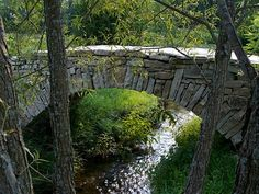 Cornish Hallow Bridge, a small Roman arch dry stone bridge built by Dry Stone Walling Across Canada (ASWAC) members in 2007, north of Cobourg Ontario.