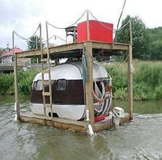 Holy Floating-Redneck-Awesome! A floating teardrop trailer/camper houseboat _ The teardrop trailer alone is really cool looking, nevermind this daring, tipsy (or so I'd think), houseboat/shantyboat approach! Wow….