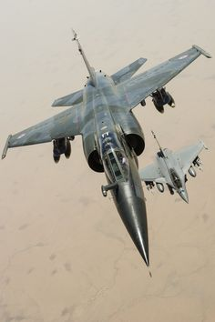 French Air Force Dassault Mirage F.1CR (foreground) and Dassault Rafale D (background)