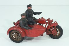 Hubley Cast Iron Police Red Motorcycle w/ Side Car Cops. On eBay at $1199.95 on 12 Sept 2014