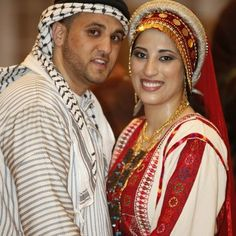 palestinian couple in traditional wedding outfits