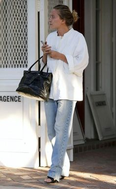Mary-Kate Olsen // messy bun, white tunic top, croc tote, baggy jeans and sandals #style #fashion #theolsentwins