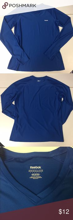 Reebok PlayDry Long Sleeve V-neck Athletic Shirt This Fitted Reebok PlayDry Long Sleeve V-neck Athletic Shirt is in excellent condition. Royal blue color. Size XL. Lightweight microfiber fabric. Quick drying. Keeps you cool and dry all day. Fitted to flatter your shape. Great for exercise workouts or everyday wear. Checkout my other Activewear, Nike, Lululemon, Fabletics and more. Reebok Tops Tees - Long Sleeve