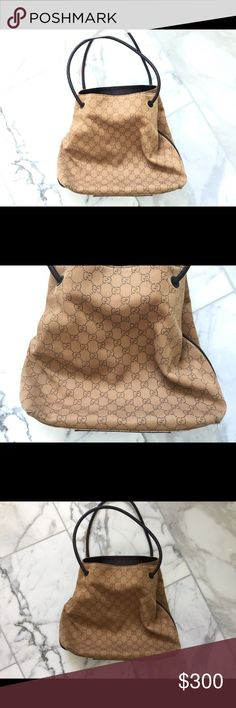 Gucci authentic canvas shoulder bag brown This beautiful and authentic Gucci handbag is in very good condition I have the duster  to go with it.  It was my very first Gucci bag I ever bought.   Very sentimental but I have others now and don't use it.   12 x12  leather piping around the bag and on the bottom   There are two spots of some wear on the bottom as shown in the photos.  There than that the bag is perfect Gucci Bags Shoulder Bags