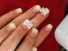 Gel nails! White tips, sparkles. Bows
